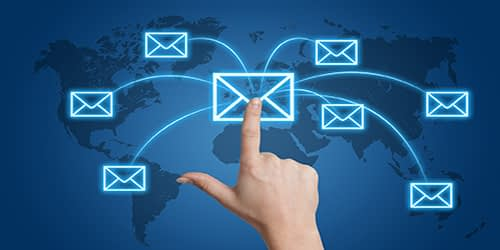 how to do email marketing, Communication concept: Hand pressing a letter icon on a world map interface